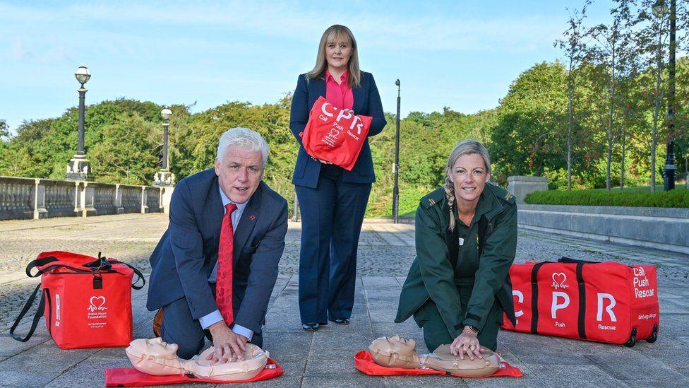 Head of British Heart Foundation Northern Ireland Fearghal McKinney, Education Minister Michelle McIlveen, Northern Ireland Ambulance Service paramedic Stephanie Leckey