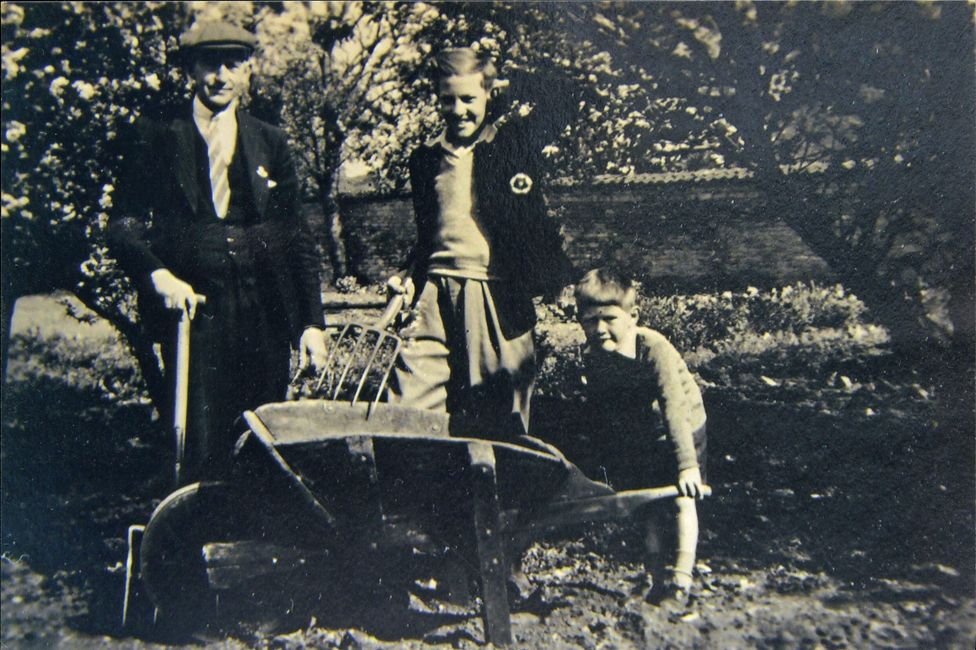 Jim Wilson with his father and brother in a garden