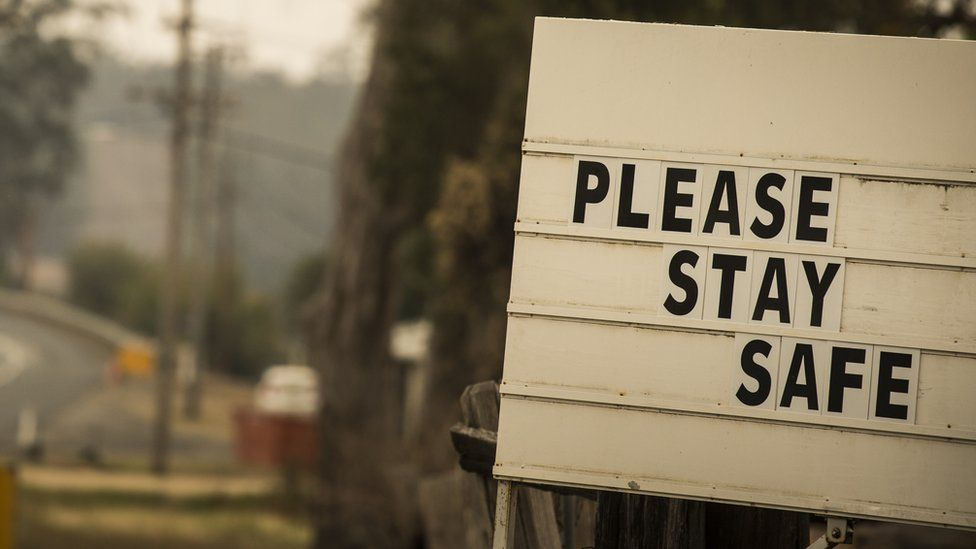 Warning sign on the side of the road in NSW reads: Please stay safe