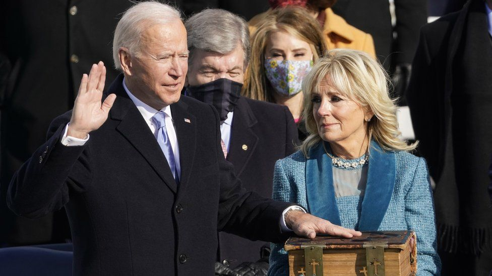 Joe Biden being sworn in as the 46th US president, watched by his wife Jill