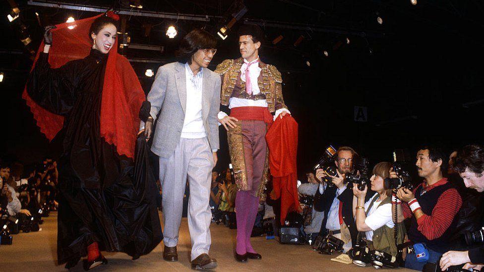 A haute couture dress and a matador's bullfighting uniform by Japanese fashion designer Kenzo Takada during his autumn-winter 1983-1984 fashion show in Paris
