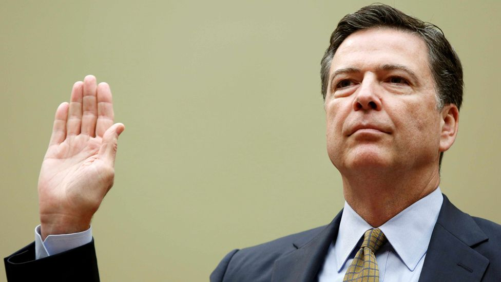 "FBI Director James Comey is sworn in before testifying at a House Oversight and Government Reform Committee on the ""Oversight of the State Department"" in Washington U.S. on July 7, 2016"