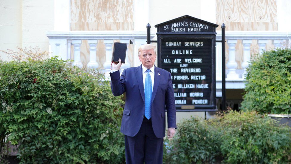 President Trump holds a bible in front of St John's Episcopal church in Washington DC