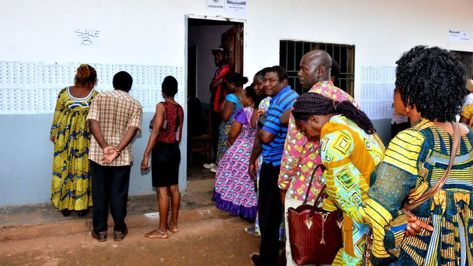 People wait in line to cast their votes at a polling station during presidential elections in Yaounde, Cameroon on October 07, 2018.