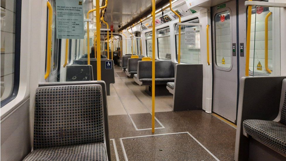 An almost-deserted Tyne and Wear Metro carriage in Newcastle-upon-Tyne