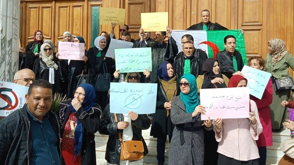 Algerian judges hold placards as they protest against President Bouteflika's bid for a fifth term in power, in the north-eastern city of Annaba on 11 March 2019