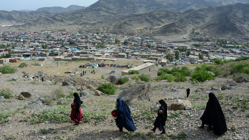 Afghan women cross the Torkham border between Afghanistan and Pakistan through the Shamshad mountains in Nangarhar province on May 12, 2016.