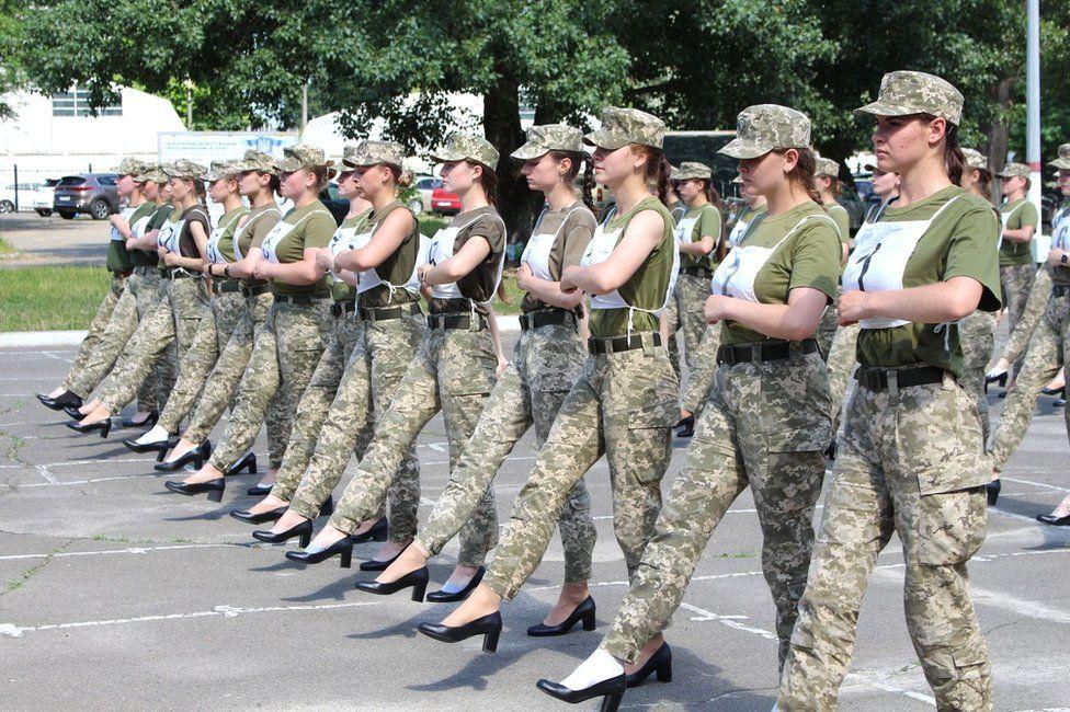 Female soldiers in Ukraine marching in high heels