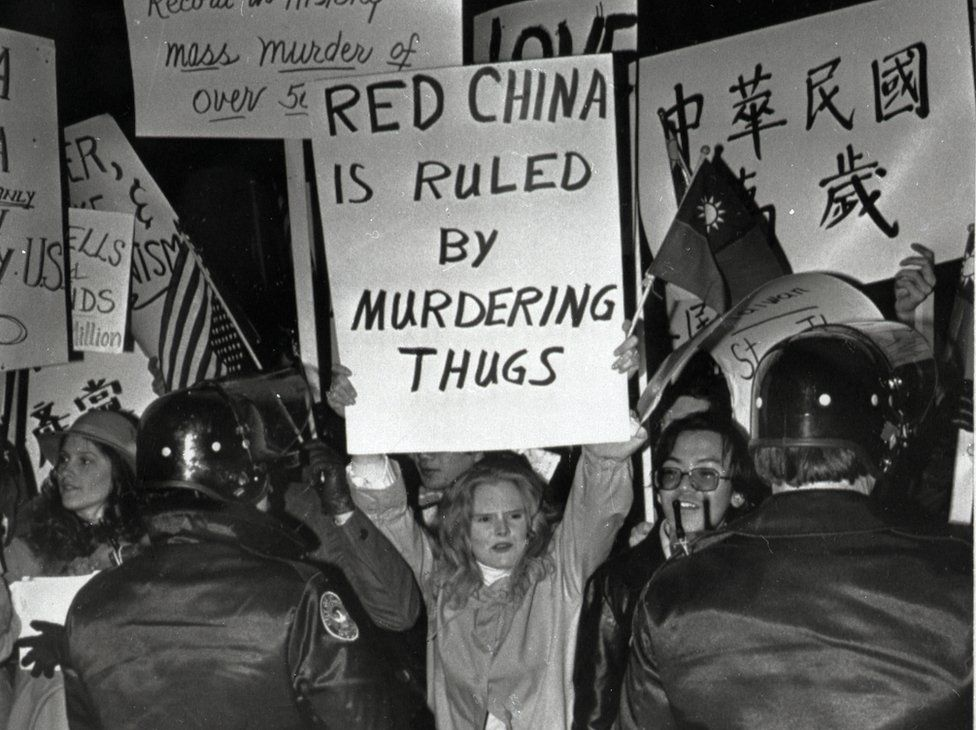 (Original Caption) 2/1/1979-Atlanta, GA: Pro-Taiwan protesters are kept back as they demonstrate in front of the Georia Governor's mansion where chinese Vice Preemier Teng Hsiao-ping was having dinnerwith Gov. Busbee. Seeveral hundred of the demonstrators assembledoutside the mansion after marching there.