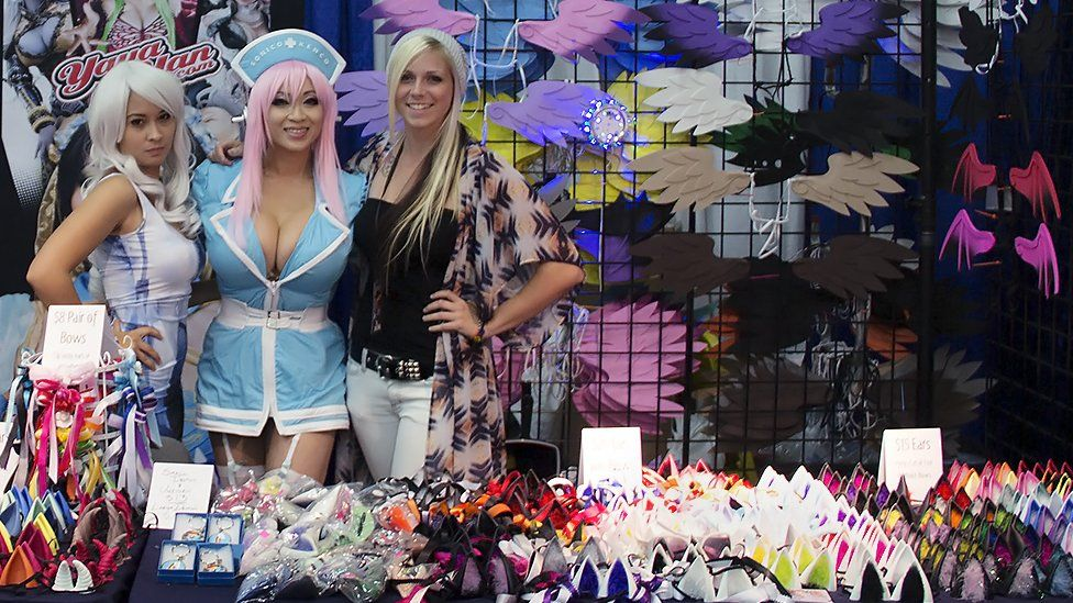 Yaya at a convention, with all of her accessories on sale