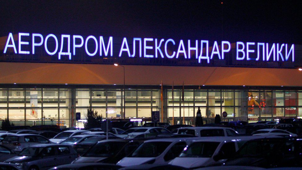Cars are parked in front of the airport Alexander the Great in Skopje
