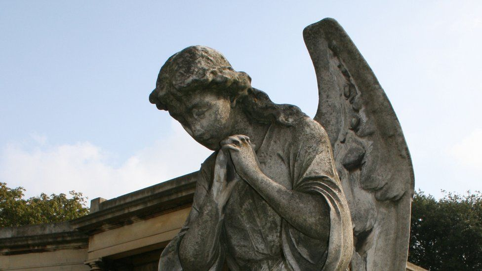 Statues of an angel in London's Brompton Cemetery