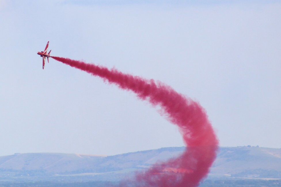 Red Arrow flying in the sky