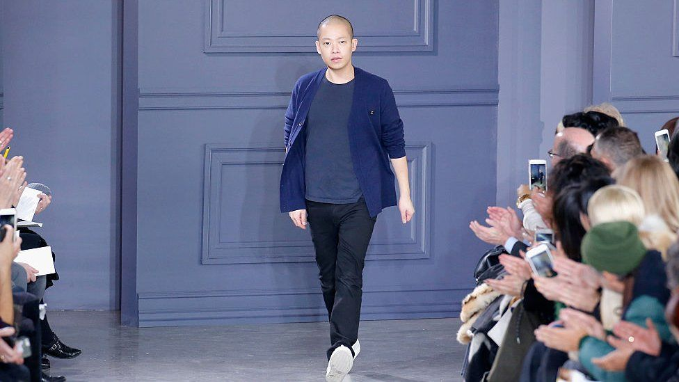 Designer Jason Wu greets the audience from the runway at Jason Wu Fall 2016 during New York Fashion Week at Spring Studios on February 12, 2016 in New York City