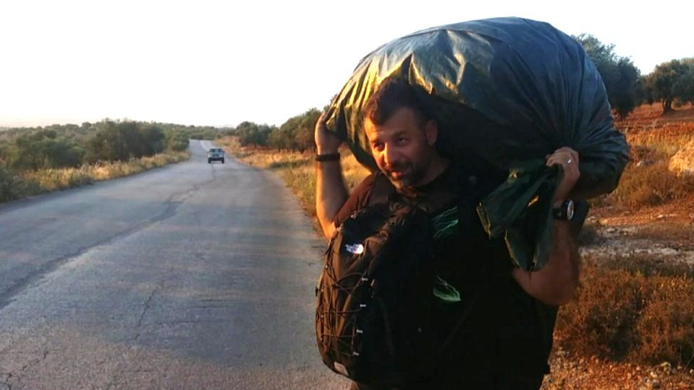 Rami Adham carrying toys