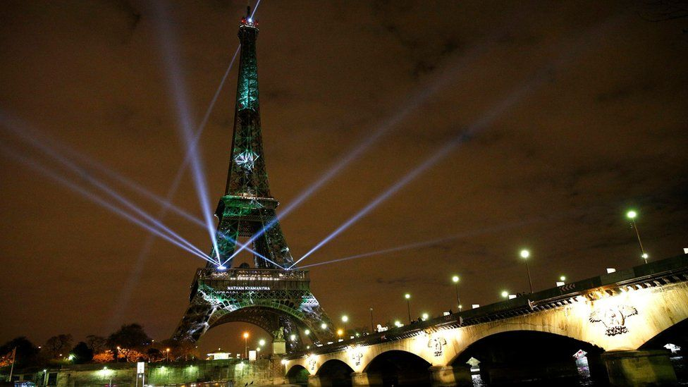 The Eiffel Tower lights up with colors and messages of hope on the eve of the COP21 climate conference in Paris, France, 29 November 2015.