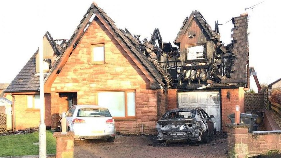 The house and car were badly damaged by the fire