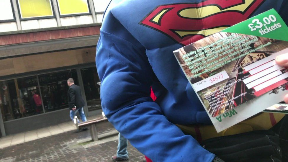 Man selling Happiness Foundation tickets
