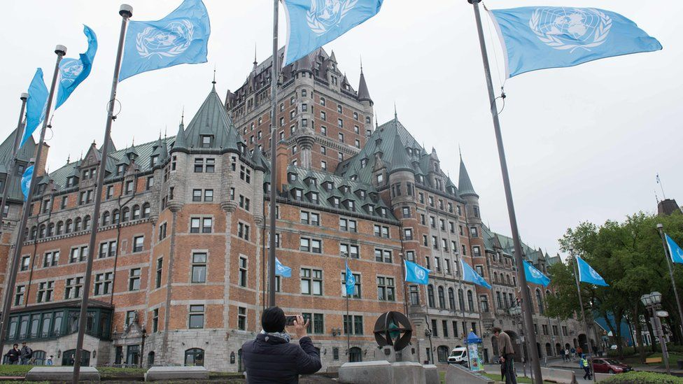 UN flags fly in front of the Fairmont Le Chateau Frontenac