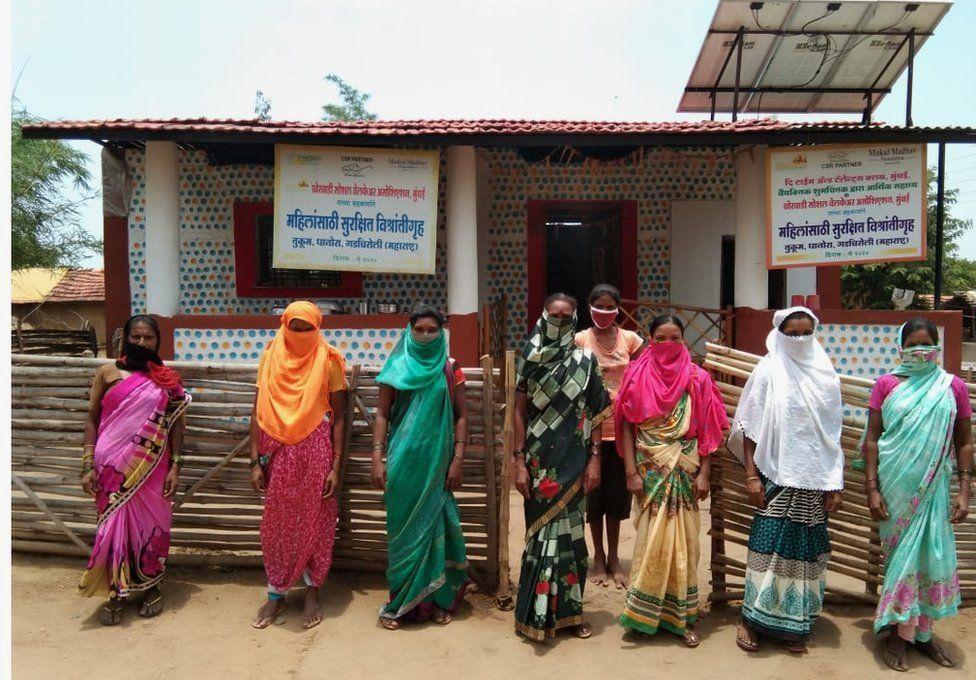 Women of Tukum outside their period hut