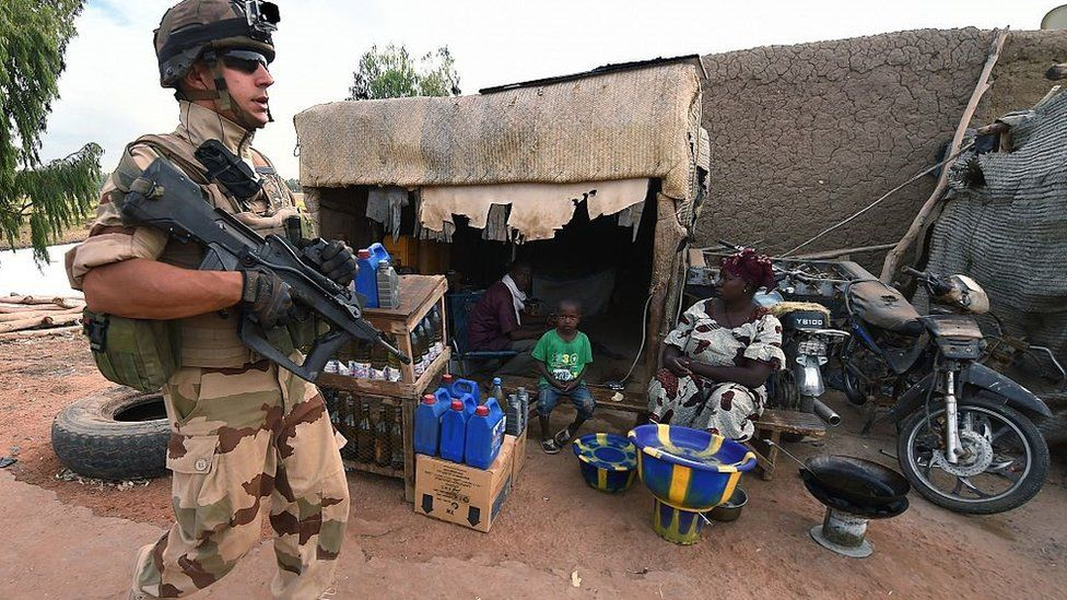 A French soldier involved in the regional anti-insurgent Operation Barkhane patrols on March 9, 2016 at the Port de Korioume near Timbuktu. France's Barkhane counter-terror mission comprises at least 3,500 soldiers deployed across five countries (Mauritania, Mali, Niger, Chad and Burkina Faso) with a mandate to combat jihadist insurgencies in the region