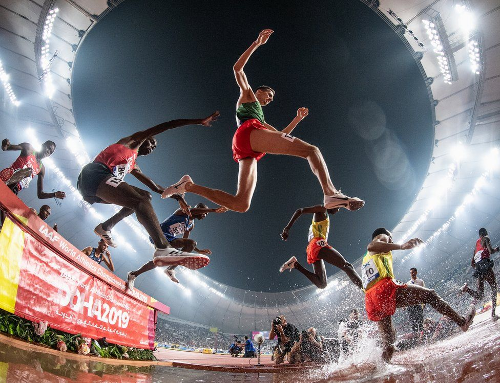 Leonard Kipkemoi Bett of Kenia and Soufiane El Bakkali of Morocco clear the water jump as they compete in the Men's 3000 metres Steeplechase final during day eight of 17th IAAF World Athletics Championships Doha 2019 at Khalifa International Stadium on October 04, 2019 in Doha, Qatar.