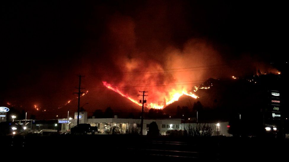 Flames rise as a wildfire burns on a hill in Kamloops, British Columbia, Canada, 1 July 2021