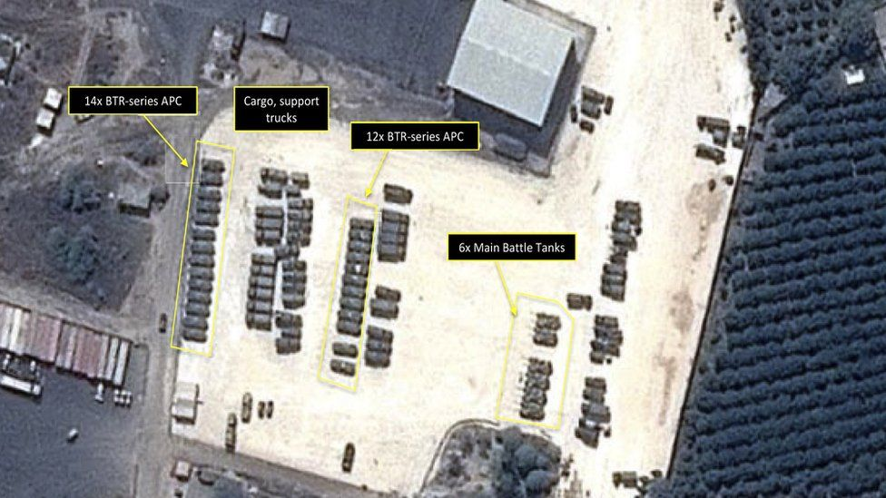 This Tuesday, Sept. 15, 2015 satellite image with annotations provided by GeoNorth, AllSource Analysis, Airbus shows Russian tanks and armed personnel carriers at an air base in Latakia province, Syria