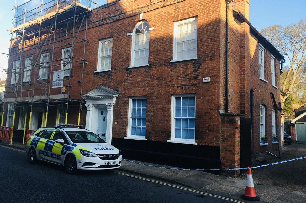 A police presence remains at the scene in Cumberland Street, Woodbridge