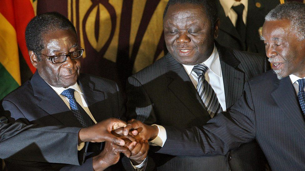 Zimbabwean leaders sign power-sharing deal
