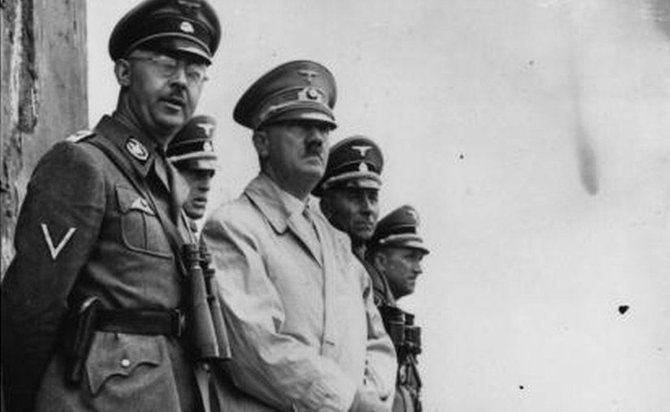 German dictator Adolf Hitler and German Nazi leader and chief of police Heinrich Himmler (left) watching Stormtroop manoeuvres.
