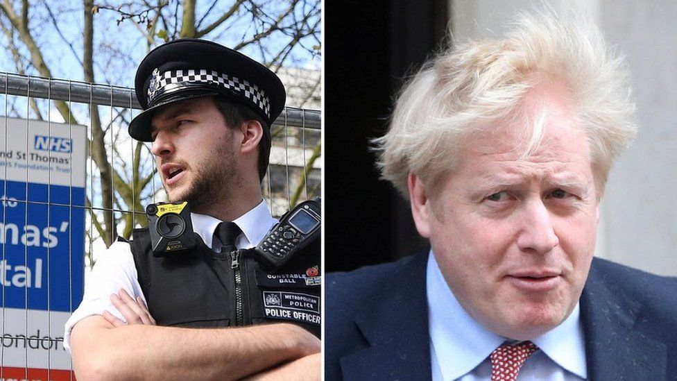 A police officer stands outside St Thomas Hospital, where Boris Johnson was admitted on Sunday
