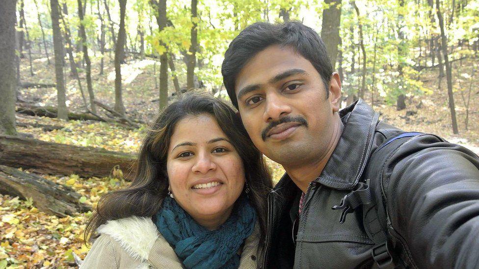 In this undated photo provided by Kranti Shalia, Srinivas Kuchibhotla, right, poses for photo with his wife Sunayana Dumala in Cedar Rapids, Iowa.
