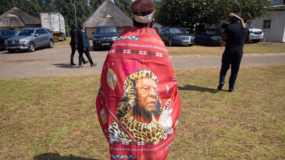 A woman wearing a wrap with the image of Zulu King Goodwill Zwelithini in Nongoma, South Africa - 18 March 2021