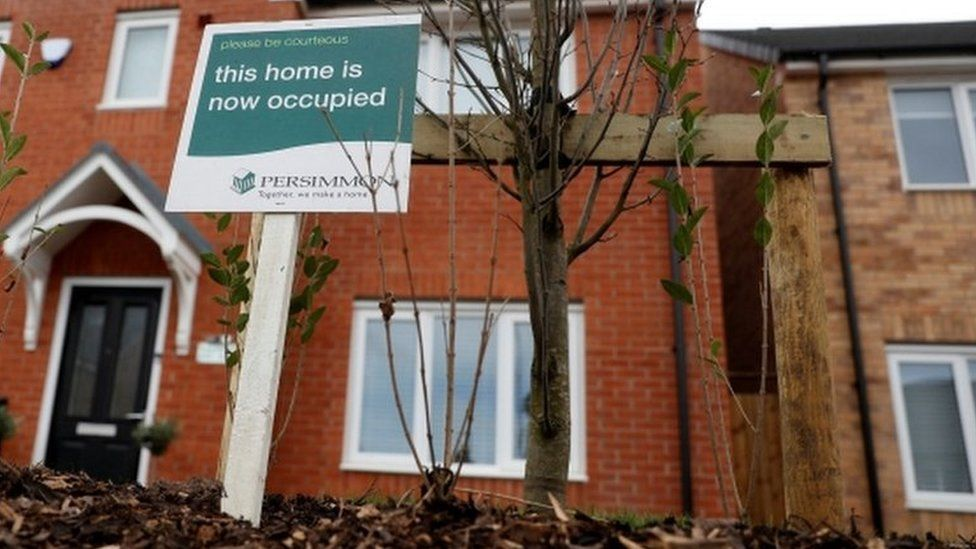 A sign outside a newly-built house (generic)