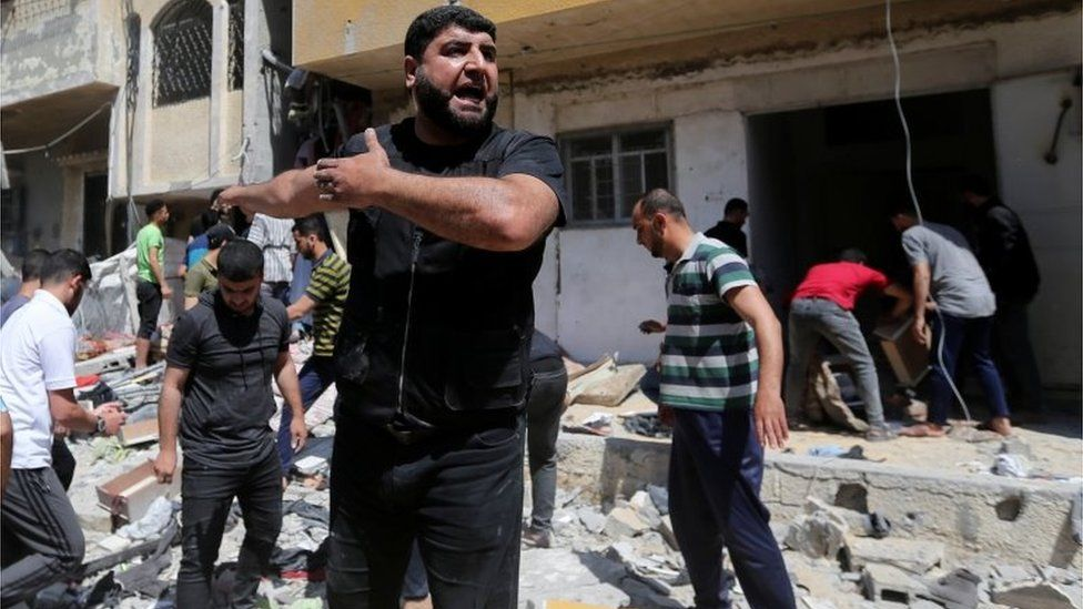 A Palestinian man reacts at the scene where a house was hit by an Israeli air strike, amid a flare-up of Israeli-Palestinian violence, in the southern Gaza Strip May 12, 2021