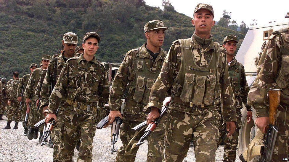 algerian soliders in 2001 following islamist massacre