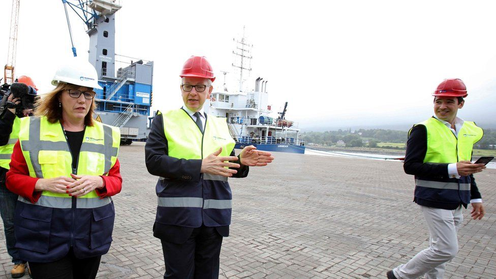 Michael Gove with Clare Guinness, CEO of Warrenpoint Harbour, in August 2019
