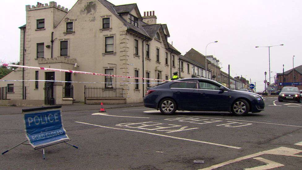 Police at the scene of a man's death in Ballymena