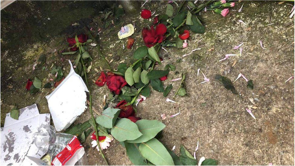 Roses strewn near the memorial