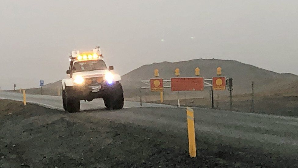 A police car blocking the road on Route 1 in Iceland