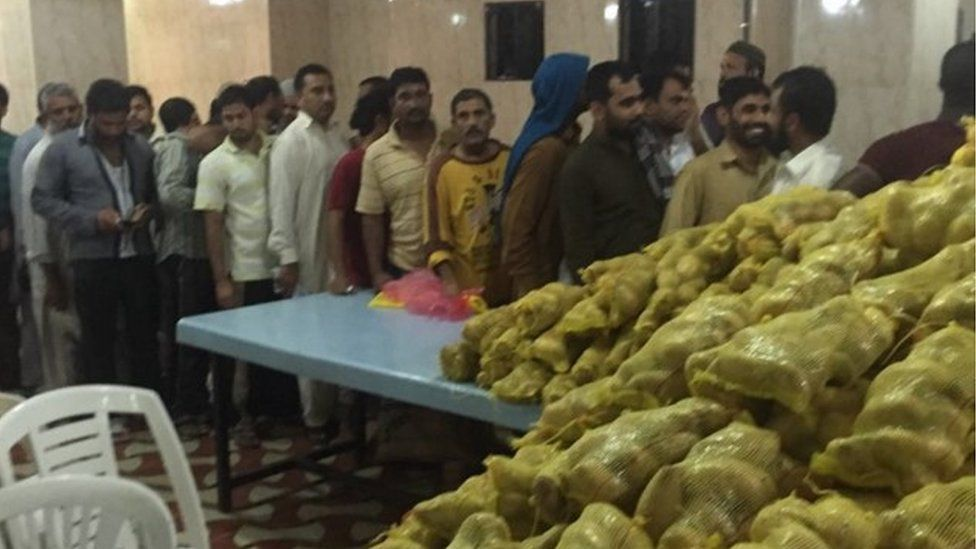 Image posted by Indian consulate in Jeddah showing Indian nationals queuing for food
