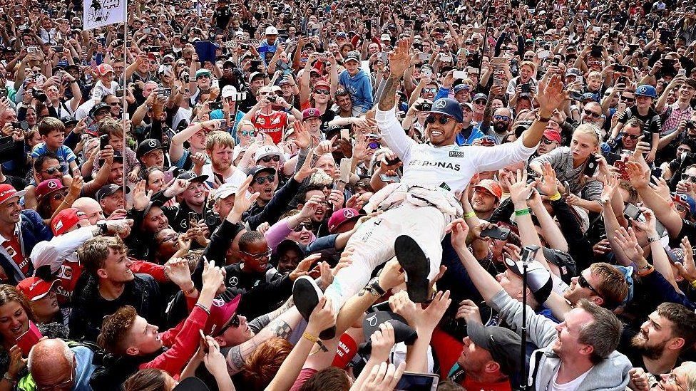 Lewis Hamilton won at Silverstone four years in a row from 2014, and celebrated in 2016 by crowd surfing