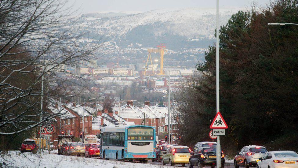 Traffic making its way into a snowy Belfast