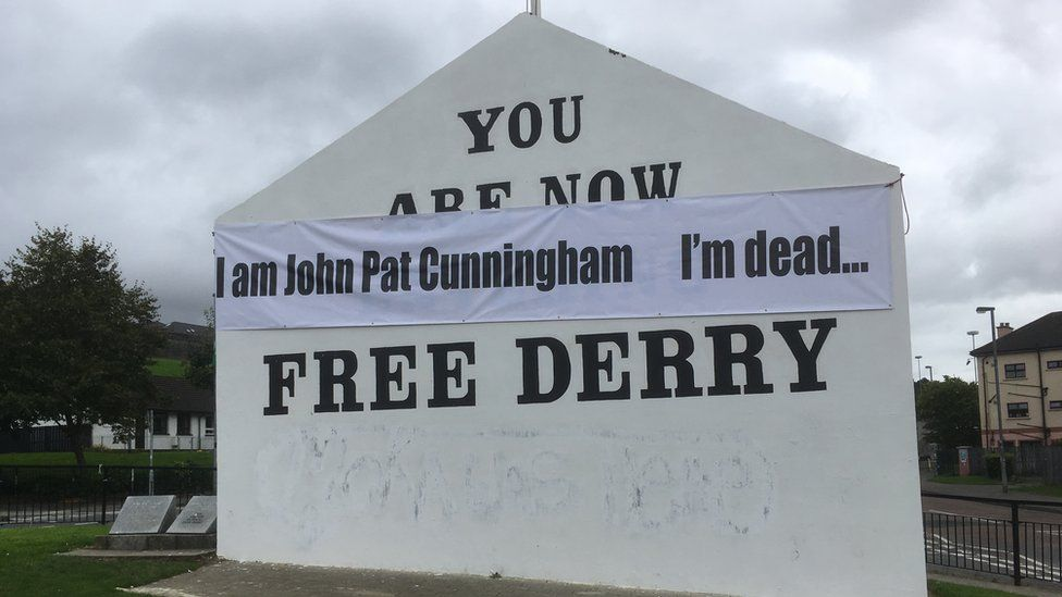 A banner in support of John Pat Cunningham's family was erected in Derry