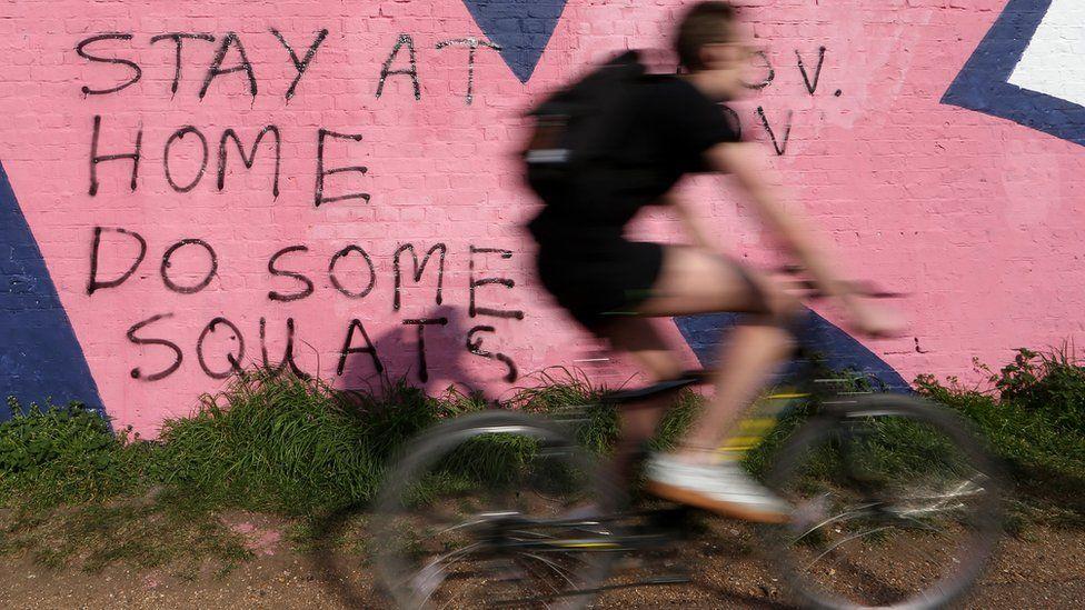 Person cycling during coronavirus