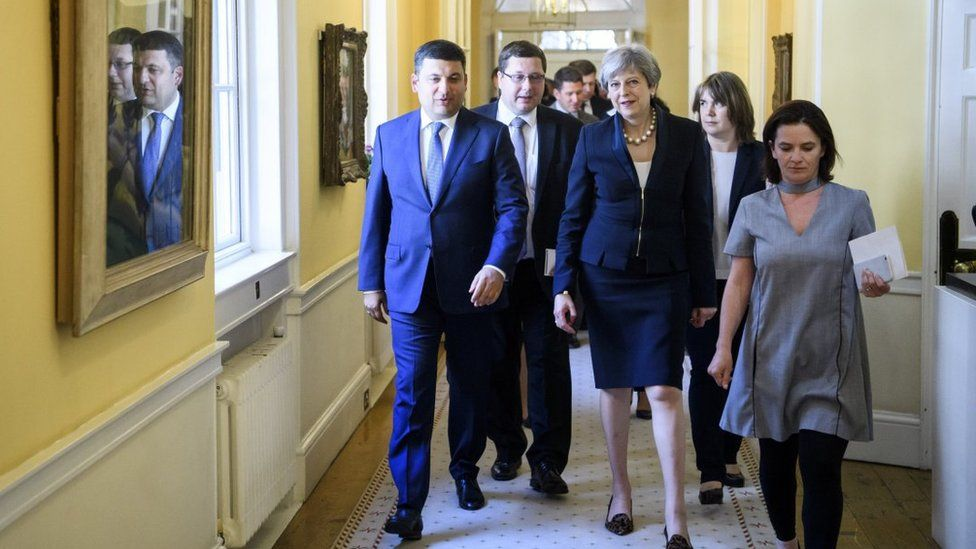Stanislav Yezhov pictured alongside Ukraine's Prime Minister Volodymyr Groysman and UK Prime Minister Theresa May in Downing Street in July 2017.