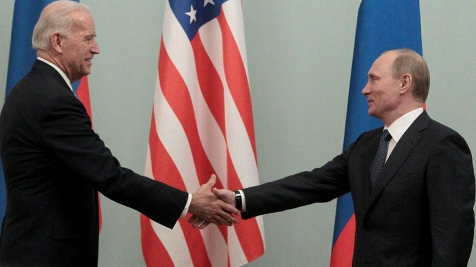 Biden and Putin shake hands