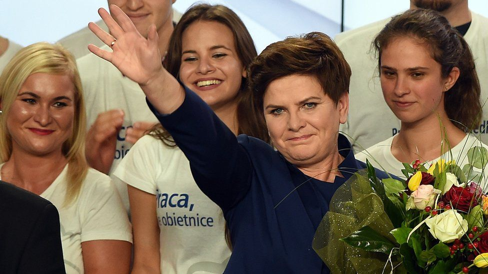 Beata Szydlo, candidate for prime minister of Law and Justice celebrates with supporters after exit poll results projected an absolute majority win for the party.