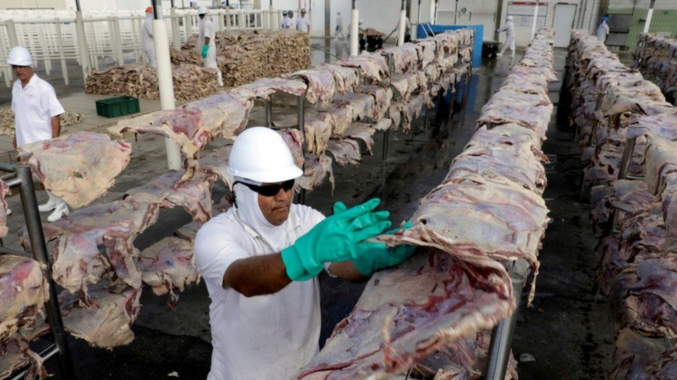 Worker at JBS processing plant in Santana de Parnaiba, Brazil, December 2017 file picture